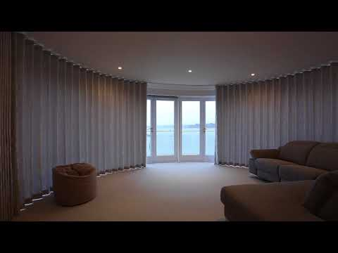 Automated curtains in Sandbanks by Bryant Interior Furnishings