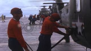 US UH-34D helicopters being refueled and takes off from a US ship in Vietnam duri...HD Stock Footage