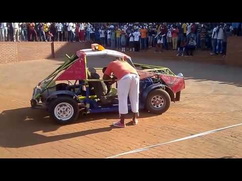 8 years old boy spinning home made car at univen