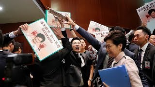 Hong Kong leader Carrie Lam forced to abandon speech after lawmakers protest