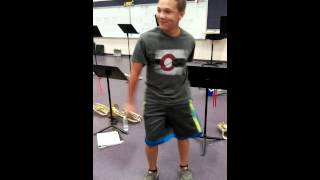 nerdy kid doing some weird air hump dance move