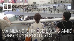 How do mainland Chinese citizens living in Hong Kong feel about the protests?
