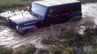 Stock Jeep Rubicon in mud offroad