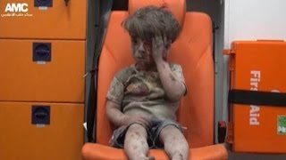 Children pulled from rubble of bombed building in Syria