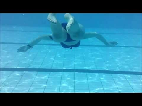 Swimming a length of the pool underwater