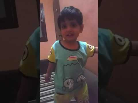 A naughty and shy kid singing a song