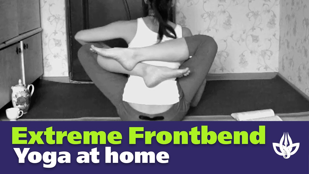 Extreme Frontbend. Yoga at home. Legs behind back.