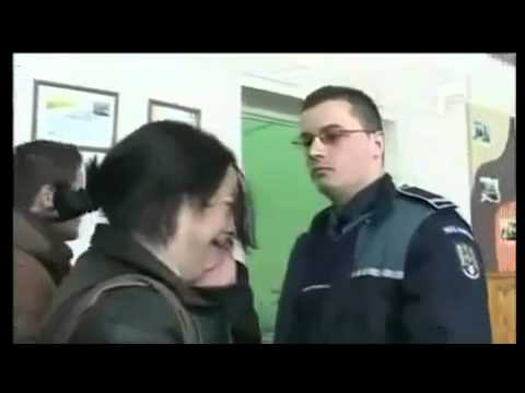Police officer slaps teacher in school