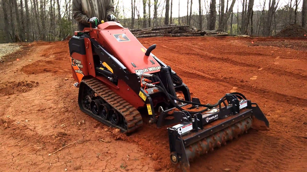 ditch witch sk850 mini skid steer with harley rake attachment youtube