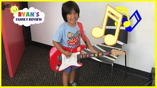 Hide N Seek Family Fun with Twin Babies  Ryan goes to his first music lesson! thumbnail