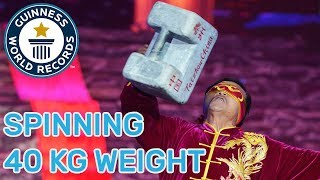 Most consecutive spinning catches of a 40kg weight (blindfolded) - Guinness World Records