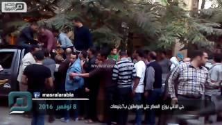 مصر العربية   حى الدقى يوزع  السكر على المواطنين ب7جنيهات