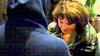 Suzyn Waldman of The New York Yankees signing autographs