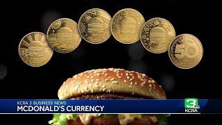 Business News: McDonald's unveils MacCoin