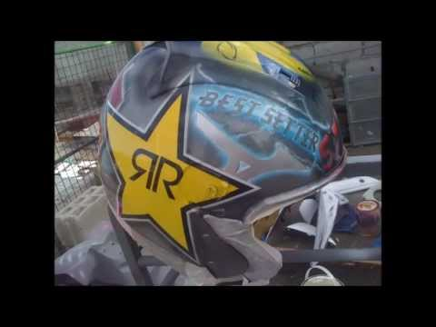 Airbrushing Rockstar logo on helmet..