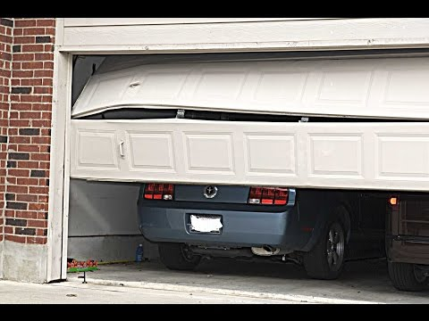garage door track hit by car | 630-271-9343