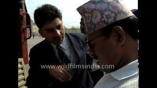 Nepal Customs officers check Indians at Nepal border