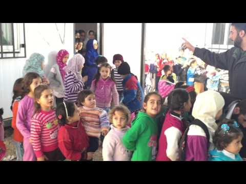 Syrian children in Lebanon's Bekaa Valley welcome MERCY Malaysia.