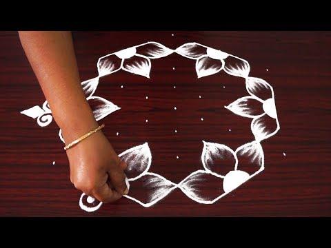 Beautiful simple rangoli designs   flower kolam designs with 9x5 dots   traditional muggulu