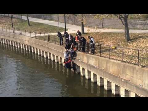 Woman rescued from river in downtown Flint