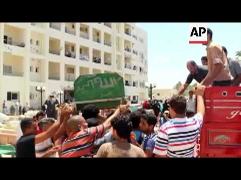 Funeral preparations for seven civilians and a soldier killed following militant attack in Sinai