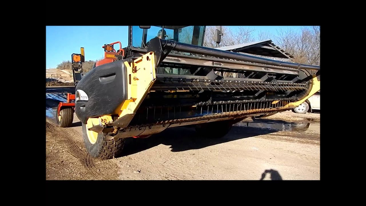 2005 New Holland HW305 self-propelled windrower for sale | sold at auction  March 12, 2014