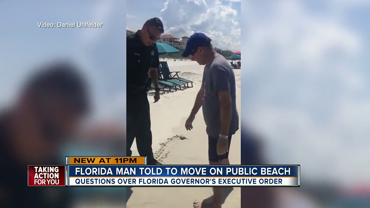 VIDEO: Deputies tell man to leave portion of public beach for trespassing following new beach law