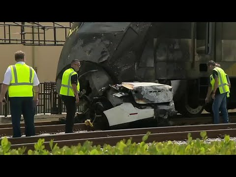 Driver dead after car is smashed by speeding train