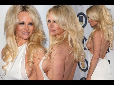 Pamela Anderson flashes some serious side-boob in a daring white dress thumbnail
