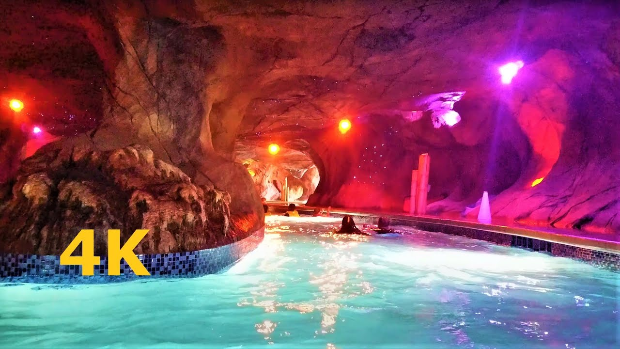 Lazy River Volcano Bay Tunnel POV Water Park Orlando Florida Cavern Cave Pool Lights