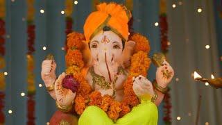Closeup shot of Lord Ganesha idol on Ganesh Chaturthi - Indian Festival. Burning incense stick and lamp