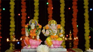Bokeh shot of Hindu gods Lord Ganesha and Goddess Laxmi on Diwali/Dipavali