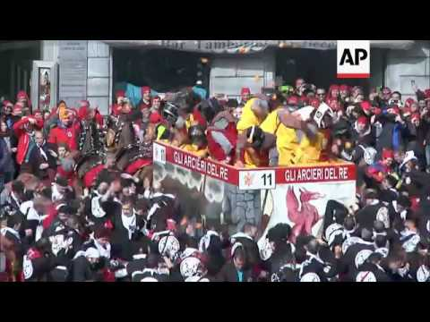 Italy carnival revellers do battle with oranges