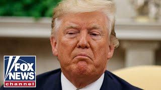 Trump slams whistleblower as 'almost a spy'