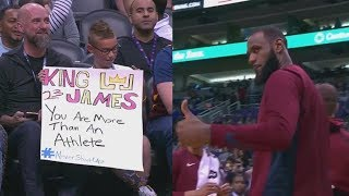 """LeBron James Gives Arm Sleeve To Young Fan Holding """"You Are More Than An Athlete"""" Sign"""