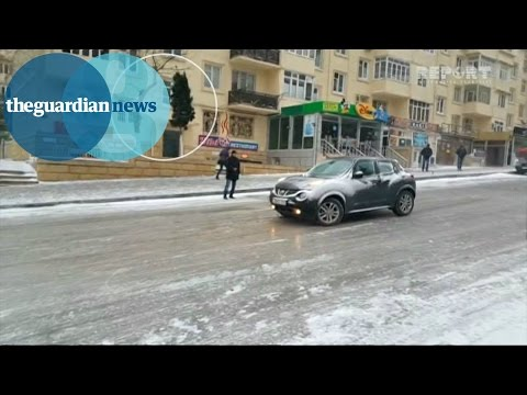 Ice Ice Baku: cars and buses negotiate ice covered road in Azerbaijan
