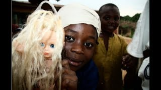 African Man Removes White Dolls From Supermarket + Petitions to Remove More from Black Communities