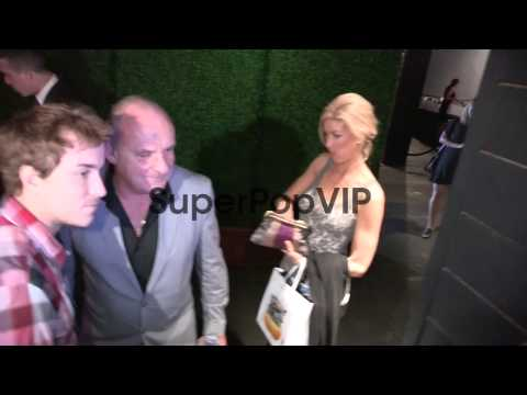 Paul Guilfoyle greets fans while departing the CBS 2012 F...
