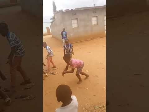 African kids dancing in the sand thumbnail