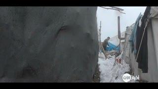 أخبار عربية - العاصفة الثلجية تأزم حياة النازحين في مخيم الزوف السوري