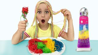 Sofia cooking colored noodles and desserts for dad with Kitchen Toys