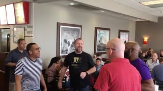 Flash mob of over 60 a cappella singers sing gospel song in Chick-fil-A