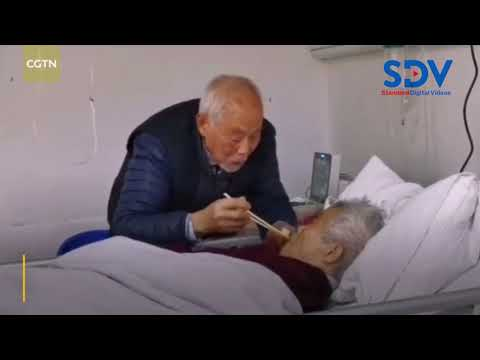 87 year old man cares for his wife as they both receive treatment for Coronavirus