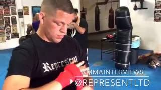 Nate Diaz wraps his hands prior to sparring with Joe Schilling at the Yard Muay Thai