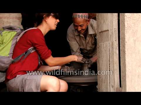 Foreign woman tourism tries her hand at pottery: Bhaktapur, Nepal