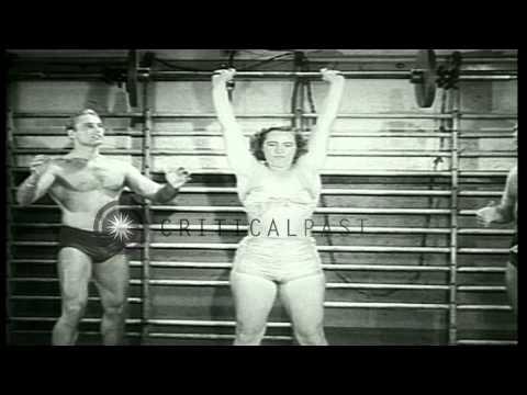 Loretta Zygowicz, strongest woman in Oak Park, Illinois. demonstrates weight lift...HD Stock Footage