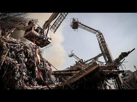 Tehran building collapse: search for dozens of missing firefighters