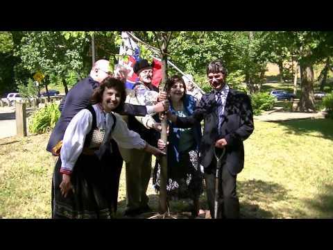Bratislava Mayor plants tree in Cleveland Slovak Cultural