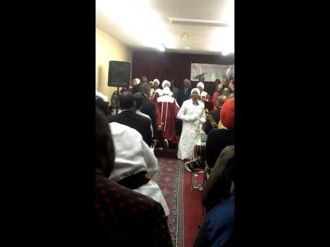 Usher Kemoney Clarke leading the choir