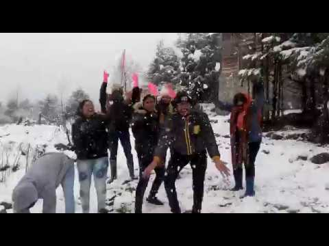 Guest Enjoying Snow Fall in Lachung | Heena Tours